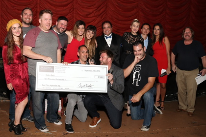 Kick A Rock accepts their check at the 48HFP